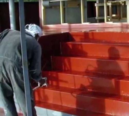 Spraying the MV Hallelujah Liveaboard dive deck steps
