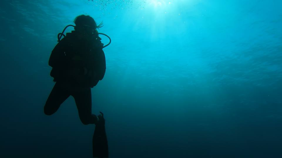 Scuba Diver silhoutte, sunshine, blue sea, bubbles